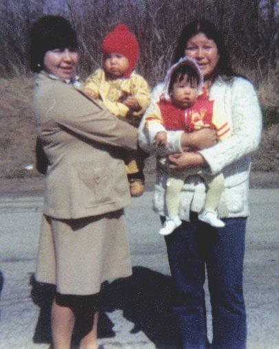 Elaine Kelly, far right, holding my cousin Marion. I'm in my aunt Lorna Pawis' arms. 1980
