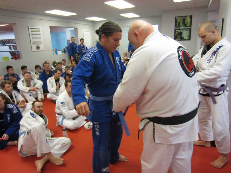 Getting my blue belt from Pat Cooligan at the Ottawa Academy of Martial Arts, December 2014