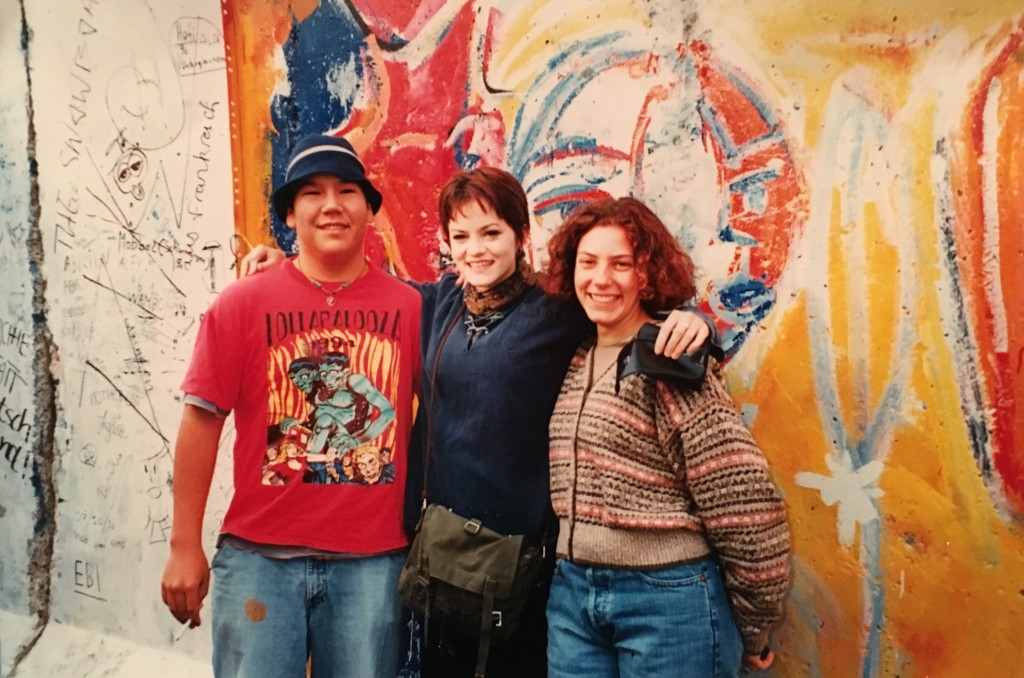 At the Berlin Wall in November 1996 with fellow exchange students.